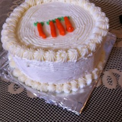 Carrot Cake XII Recipe - This carrot cake uses canned carrots as well as pineapple, walnuts and coconut. If you don't have canned carrots, use a cup of mashed cooked carrots.