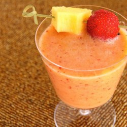 Strawberry, Pear, Pineapple, and Mint Smoothie Recipe - Apple juice, strawberries, pears, pineapple, and mint combine to make this refreshing all-fruit smoothie.
