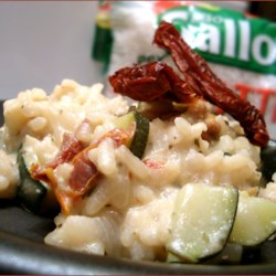 Zucchini Risotto Recipe - Rich and creamy risotto with a burst of color from sun dried tomatoes and zucchini.
