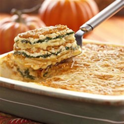 Au Gratin-Pumpkin Layered Casserole Recipe - In this Idahoan approach to lasagna, we've layered our creamy Au Gratin Homestyle Potatoes with vitamin-rich kale or spinach and a pumpkin Parmesan sauce for a delicious taste of autumn.