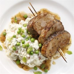 Chevre Mashed Potatoes with Peas and Grilled Pork Tenderloin Recipe - This dish is showy enough for company but fast enough to put together for a weeknight. The goat cheese adds a wonderful creaminess and the peas a fresh burst of flavor.