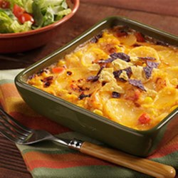 Fiesta Au Gratin Recipe - Add a little Mexican flair to your potatoes with this recipe. Simple to prepare using only our Au Gratin Homestyle Casserole and a few Mexican food staples. Best served topped with crushed tortilla chips.