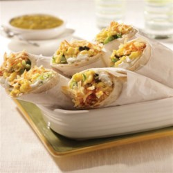 Hash Brown Breakfast Burritos Recipe - This simple recipe is a wonderful addition to your breakfast offerings. Add your own flair by customizing the filling!