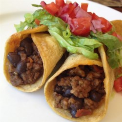 Taco Mix with Black Beans Recipe - This simple mixture of beef, black beans, salsa, and taco seasoning can be used as a filling in a variety of Mexican-style dishes.