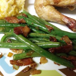 Stovetop Green Beans Recipe - This mixture of green beans, onions, bacon, and cheese is a perfect substitution for the traditional green bean casserole.