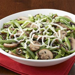 French Onion & Mushroom Green Beans Recipe - French-cut green beans, sliced sweet onions, mushrooms, and thyme are topped with shredded cheese for a quick, delicious side dish.