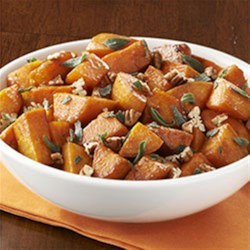 Molasses Glazed Sweet Potatoes with Sage & Pecans Recipe - Roasted sweet potato cubes are quickly sauteed with molasses, cinnamon and cayenne pepper and served with browned sage and chopped pecans.