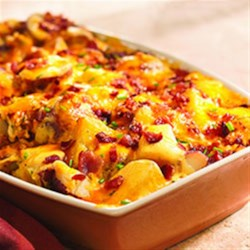 Twice Baked Potato Casserole from Crisco(R) Recipe - In this family pleaser, red potatoes are cooked until tender, then baked in a creamy, cheesy sauce with chives and paprika until golden brown.