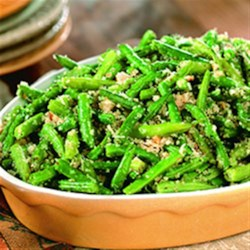 Herbed Green Bean Casserole Recipe - Herbs and Parmesan cheese blend perfectly in this great green bean side dish. You'll have them begging for seconds!