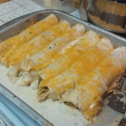 Chicken Enchiladas Suizas Recipe - 'Suizas,' Spanish for Swiss, refers to the creamy white sauce that tops these chicken and green chile-stuffed enchiladas.