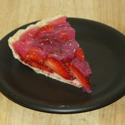 Big Guy Strawberry Pie Recipe - Fresh strawberries are piled into a prebaked pie shell, topped with a sweet syrup, and chilled until firm. Serve with a dollop of whipped cream.