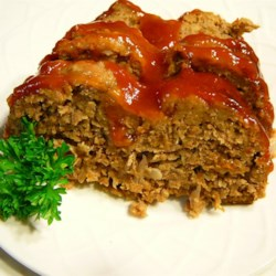 Amish Meatloaf Recipe - A recipe for Amish meatloaf topped with bacon strips and a ketchup glaze that I had while in Amish country in Holmes County, Ohio.