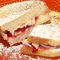 Monte Cristo Sandwiches Recipe - Classic recipe for a crispy batter-dipped grilled ham and cheese sandwich.