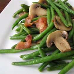 Mushroom and Bacon Green Beans Recipe - Mushrooms, bacon, and green beans are cooked together in a skillet creating a quick and easy side dish that is ready in less than 30 minutes.