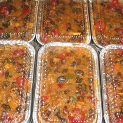 Festive Fruitcake I Recipe - This is a large recipe that is rich and dark.  Make a few weeks ahead of time. Apple juice can be substituted for orange juice. Originally submitted to CakeRecipe.com.