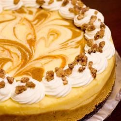 Marbled Pumpkin Cheesecake Recipe - This is a wonderful pumpkin cheesecake with a gingersnap crust. The gingersnap really does make a difference.