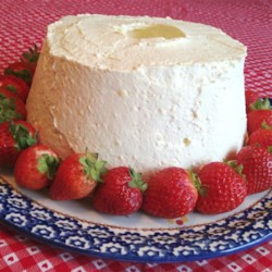 Angel Food Refrigerator Cake Recipe - Vanilla pudding mix, lemon yogurt, and whipped topping combine to make a frosting for store-bought angel food cake for a very quick and easy dessert for last-minute guests.