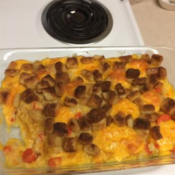 Carrot Casserole Recipe - Carrots are baked with cream of celery soup and processed cheese.  Buttery, seasoned croutons top it all off.