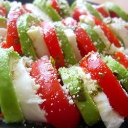 Insalata Tricolore Recipe - Sliced beefsteak tomatoes are topped with avocado slices and fresh mozzarella, then drizzled with olive oil and balsamic vinegar. When I was in Italy, I ate this as much as possible. It's so easy and so delicious. Perfect as a starter for entertaining or a simple lunch. Have some ciabatta bread and olive oil on the side for dipping.