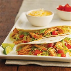 Slow Cooker Chicken Tinga Tacos Recipe - Chicken stewed in a spicy tomato sauce is easy to make and delicious for tacos or tostadas.
