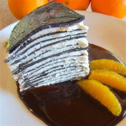 Chocolate Crepe Cake with Salted Chocolate Orange Sauce Recipe - A delicious cake that combines flavors that everyone loves--chocolate and orange.