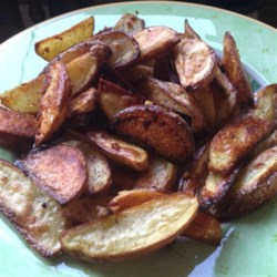 Garlicky Salt and Pepper Fries Recipe - Tossed in butter, garlic, olive oil, salt and pepper, these potato wedges are roasted until browned and crispy.
