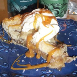 Salted Caramel Apple Pie a la Mode Recipe - Apple pie in a tender crust is served warm with vanilla ice cream, a drizzle of caramel topping, and a pinch of Diamond Crystal(R) Coarse Sea Salt.