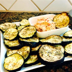 Salted Eggplant Chips with Bruschetta Spread Recipe - Thinly sliced eggplant, salted and drizzled with olive oil and herbs, are baked until crisp and topped with a tomato and cream cheese spread for a delicious snack or appetizer.