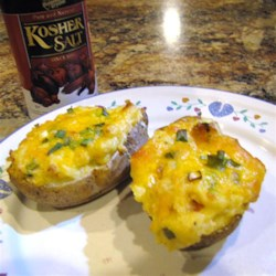 Spud's Twice-Baked Taters Recipe - Classic twice-baked potatoes with a creamy potato filling, bacon, and Cheddar cheese are a true family favorite.