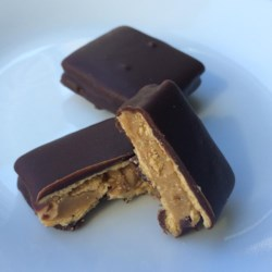 Mock Butterfinger(R) Recipe - Thin wheat crackers are sandwiched around peanut butter and dipped in chocolate creating a treat that tastes like a Butterfinger(R) candy bar.