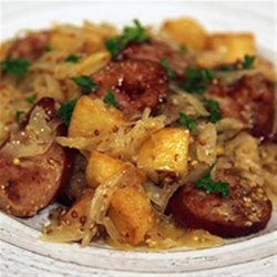 Smoked Sausage with Potatoes, Sauerkraut & Ale Recipe - This German-inspired one-skillet dinner combines smoked sausage slices, potatoes, sauerkraut, ale and whole grain mustard for a quick and hearty meal.