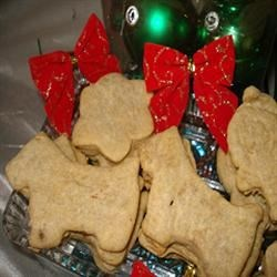 Best Friend Doggie Biscuits Recipe - These rolled, cut-out cookies for pooches feature a healthful, crunchy blend of cornmeal, all-purpose flour, chicken stock, an egg, and chopped parsley.