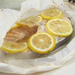 Parchment Baked Salmon Recipe - A salmon fillet is steamed in parchment paper with lemon and basil for a light, quick meal for two.