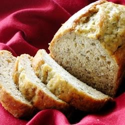 Janine's Best Banana Bread Recipe -  Ripe bananas are the key to this sweet, no-frills delight. Hidden inside its sweet, slightly crunchy crust is soft and chewy banana goodness.