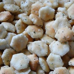 Seasoned Oyster Crackers Recipe - Oyster crackers coated in ranch dressing mix and herbs are perfect for topping salads!