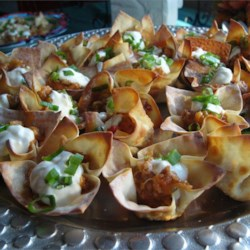 Sausage Flowers Recipe - Cups made from wonton wrappers are filled with a flavorful cheese and sausage mixture, then baked and topped with sour cream and chopped green onions.