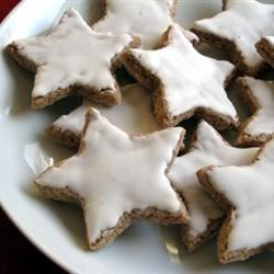 "Cinnamon Stars Recipe - These German ""Zimt Sterne"" are made with ground almonds instead of flour for a delicious gluten-free Christmas cookie. They're brushed with a shiny lemon glaze for a pretty finish."