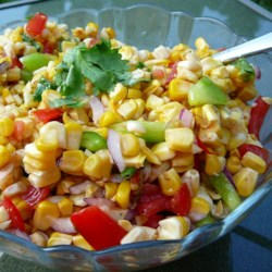 Grilled Corn Salad Recipe - Fresh corn is grilled and sliced off of the cob while still warm in this hearty grilled side.