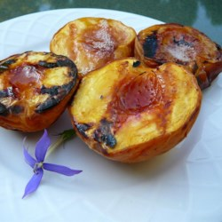 Sweet Grilled Peaches Recipe - Peaches are spruced up with a little honey and a dash of cinnamon before being packaged into foil and cooked on the grill. As my husband says, these taste like a peach cobbler without the crust!