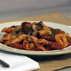 Smoked Sausage & Mushroom Pasta Marinara Recipe - Smoked sausage slices and mushrooms are simmered in your favorite marinara sauce then tossed with Parmesan cheese and hot cooked pasta.