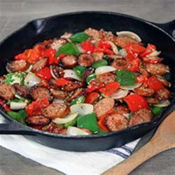 Classic Smoked Sausage & Peppers Recipe - Sliced smoked sausage is sauteed with onions and red and green bell peppers for a quick and colorful weeknight dinner.