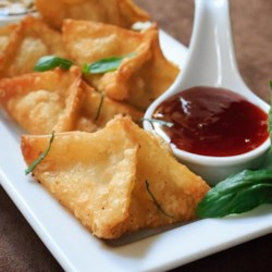 Crab Rangoon I Recipe - This Asian appetizer relies on ready-made wonton wrappers for its crunchy coating; minced cilantro gives the seafood stuffing a modern kick.