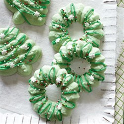 Holiday Spritz Cookies Recipe - These classic holiday cookies made with a cookie press are everybody's favorite, both to decorate and to eat.