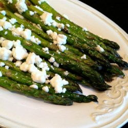 Roasted Asparagus with Herb Goat Cheese Recipe - Roasted asparagus with herbed goat cheese is quick and easy to prepare and a great side dish in the spring.