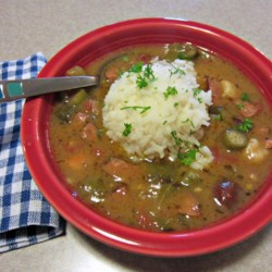 Good New Orleans Creole Gumbo Recipe and Video - With a slow cooked roux and gumbo file powder flavoring the shrimp, crabmeat, and andouille sausage, this gumbo is an authentic creole meal.
