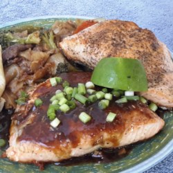 Salmon in Oyster Sauce Recipe - Salmon is cooked and served with a thickened oyster sauce mixture seasoned with garlic and green onions! Rice is the perfect accompaniment to this savory dish.