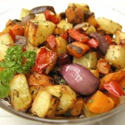 Roasted Vegetables Recipe - Butternut squash, sweet potato, red peppers, and Yukon Gold potatoes are roasted with olive oil, balsamic vinegar, and herbs in this easy side dish.
