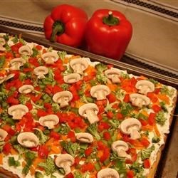 Cool Veggie Pizza Recipe - This appetizer is a cool pizza made with refrigerated crescent roll dough and topped with finely chopped vegetables. Zucchini, mushrooms, green peppers, green onions and tomatoes all work well as toppings.