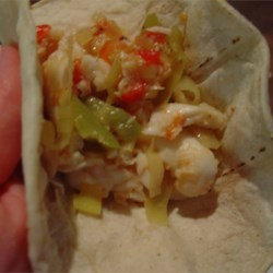 Anaheim Fish Tacos Recipe - Delicious halibut is cooked with an array of spicy flavors to make the perfect filling for tacos!