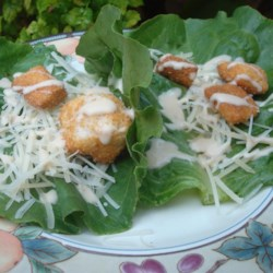 Caesar Salad Bites Recipe - Individual romaine lettuce leaves are topped with a little bit of Caesar dressing and Parmesan cheese creating Caesar salad bites perfect for parties.